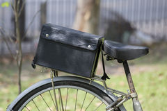 Bicycle pannier with big black bag Royalty Free Stock Photography