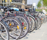 Bicycle parade. Line of bicycles in front of a train station Royalty Free Stock Photo