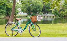 Bicycle in the park. Bicycle is found parked by a pond. Cycling is becoming more popular exercise in Thailand Stock Photography