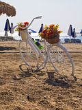 Bicycle parked on a beach next to the umbrellas. Bicycle parked on a beach next to the sea umbrellas Stock Image