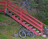 Bicycle parked below the stairs Royalty Free Stock Photography