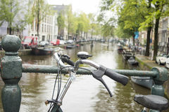 Bicycle parked on a bridge in Amsterdam Royalty Free Stock Photo