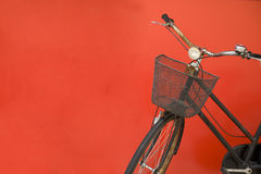 Bicycle Parked By A Red Wall Stock Image