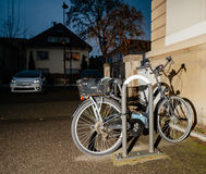 Bicycle parked in city at night Stock Image