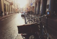 Bicycle parked in a city street Royalty Free Stock Images