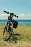 Bicycle parked on the  coast Stock Image
