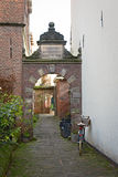 Bicycle parked at narrow street in Deventer, a typical Dutch scene Stock Images