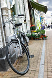 Bicycle is parked near  flower shop Stock Images