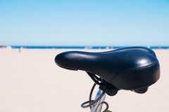 Bicycle parked next to the ocean Stock Images
