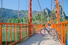 Bicycle parked on the orange bridge stock photos