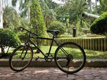 Bicycle parked  in palace tropical green garden Stock Photo