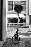 Bicycle parked in the pedestrian area sign Stock Image