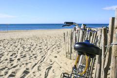 Bicycle parked on the sand of the Beach Royalty Free Stock Photo