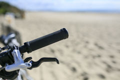 Bicycle parked on the sand of the Beach Stock Images