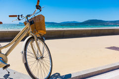 Bicycle parked by the sea in Sardinia Royalty Free Stock Images
