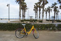 A bicycle parked in the seafront of the popular La Malvarrosa beach, in Valencia, Spain. A bicycle parked in the seafront of the popular La Malvarrosa beach, in Royalty Free Stock Photo