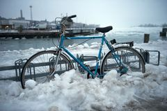 Bicycle parked in snow and ice Royalty Free Stock Photography