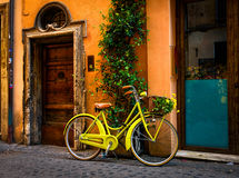 Bicycle parked on the street in Rome. Italy Stock Photography