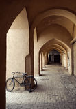 Bicycle Parked in a Traditional Passage with Clay Arches in City of Yazd. A Bicycle parked in an old passage with traditional clay arches in the city of Yazd Royalty Free Stock Photo