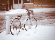 Bicycle parked in winter scene Stock Image
