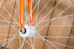 Bicycle parked with wood wall, close up part of bicycle Stock Images