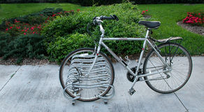 Bicycle Parking 2. Profile of a bicycle in a rack stock images