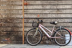 Bicycle parking against Old House Stock Images
