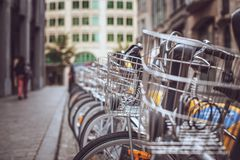 Bicycle parking in the city. City bicycles on street parking. Urban style Stock Images