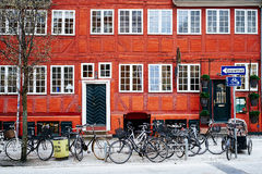Bicycle Parking in Copenhagen. Bicycles parked in front of a red historical building in Copenhagen, Denmark Royalty Free Stock Images