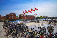 Bicycle parking at the embankment near The Black Diamond, The Copenhagen Royal Library. COPENHAGEN, DENMARK - June 15: Bicycle parking at the embankment near The Stock Photo