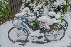 Bicycle parking, after heavy snowfall. Snow-covered rental bikes. Royalty Free Stock Images