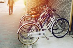 Bicycle parking in japan urban. With blur man walking royalty free stock photos