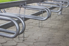 Bicycle parking lot. And chain for locking Stock Images