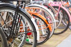 Bicycle parking lot in the city street of Amsterdam, Netherlands. Iconic transport in Amsterdam. stock photography