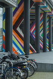 Bicycle parking lot in The Hague Netherlands at modern architecture building background Royalty Free Stock Photo
