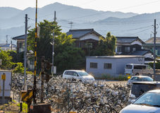 Bicycle Parking Lot near the Train Station in Japan. There are lots of bicycles parked the parking lot near the train station in Yamaguchi Prefecture, Japan Stock Photos