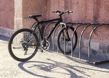 Bicycle in parking lot. Outdoors Royalty Free Stock Images