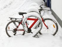 Bicycle in the parking lot after a snowfall Stock Photography