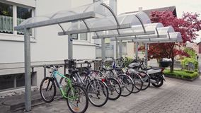 Bicycle parking near the house. 4k stock footage