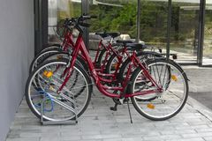 Bicycle parking near the house, urban lifestyle. Cycling through the city, transportation.Close up stock image