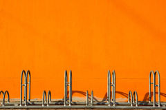 Bicycle Parking and orange wall Royalty Free Stock Images