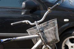 Bicycle on parking place. The bicycle on parking place in the same row with the car looks exotically Stock Photos