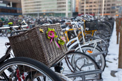 Bicycle parking place. Focus on basket. Bicycle parking place in the Hague Stock Images