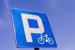 Bicycle parking road sign. Parking road sign with bicycle symbol over blue clear sky Stock Photography