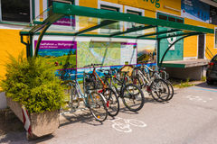 Bicycle parking with roof and map of the area. Royalty Free Stock Photo