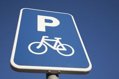 Bicycle Parking Sign. Against Blue Sky Background Royalty Free Stock Photography