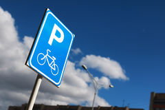 Bicycle parking sign on a background of the sky Stock Photos