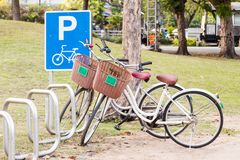 Bicycle parking sign and the bicycle. Bicycle parking sign and the bicycle in the rack in the park Stock Images