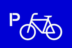 Bicycle parking sign. Isolated on blue background stock photo