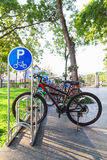 Bicycle parking sign in public park Royalty Free Stock Image